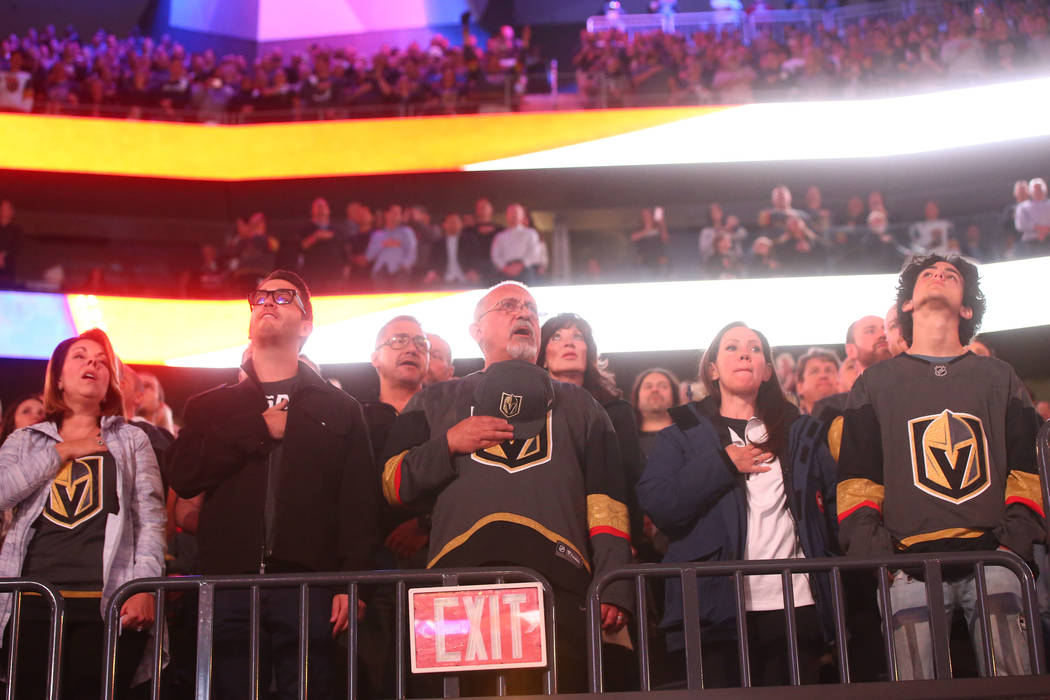 Fans sing the national anthem before an NHL hockey game between the Vegas Golden Knights and Arizona Coyotes at T-Mobile Arena in Las Vegas on Tuesday, Oct. 10, 2017. Chase Stevens Las Vegas Revie ...