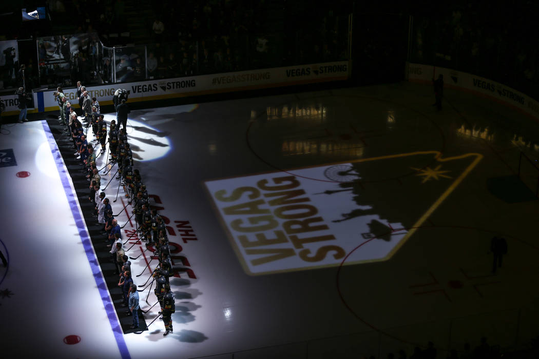 Victims and first responders of the Route 91 Harvest Festival shooting are honored before the start of an NHL hockey game between the Vegas Golden Knights and the Arizona Coyotes at T-Mobile Arena ...