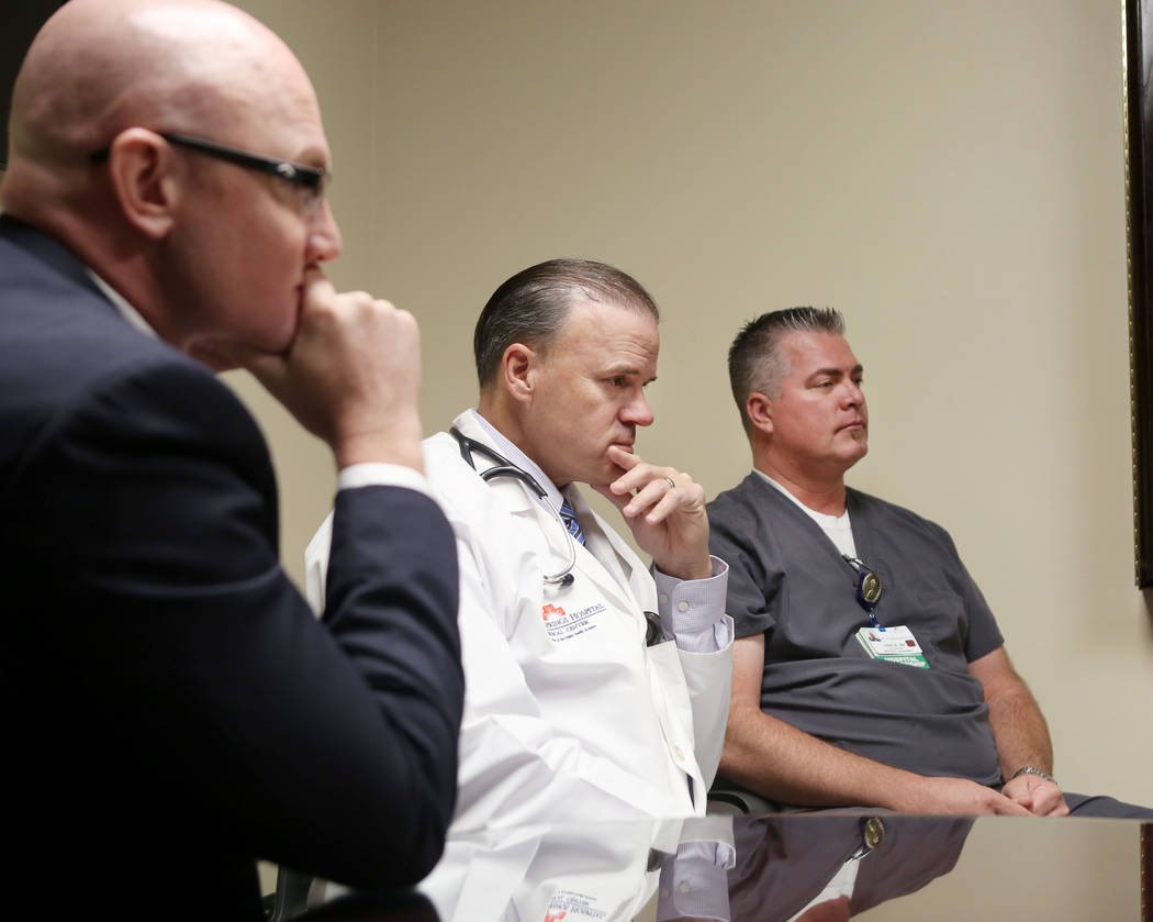 CEO of Desert Springs Hospital Ryan Jensen, left, and hospitalist Lonnie Empey, and emergency room clinical supervisor David Barrett, at Desert Springs Hospital in Las Vegas, Tuesday, Oct. 10, 201 ...