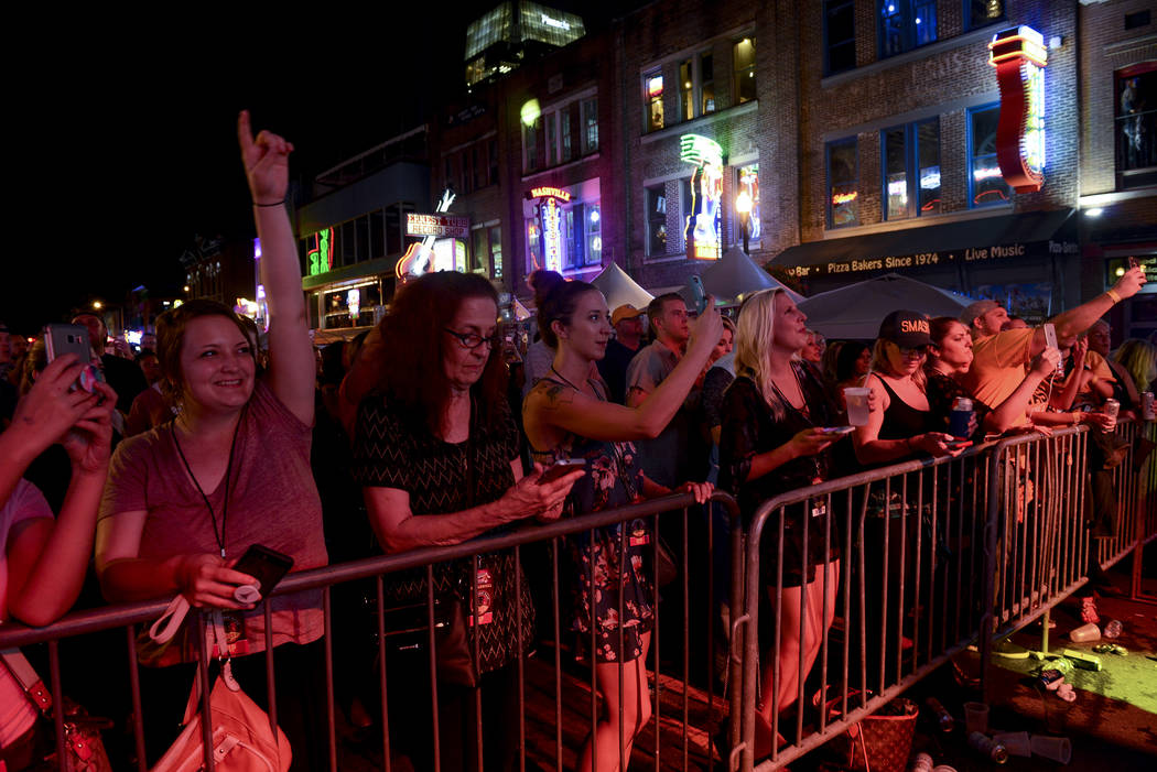Fans line a section of Nashville's Lower Broadway during the 57th anniversary party for Tootsie's Orchid Lounge. (Ben Neely)