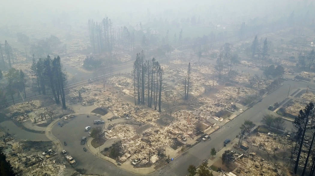 This aerial image shows a neighborhood that was destroyed by a wildfire in Santa Rosa, Calif., Tuesday, Oct. 10, 2017. Newly homeless residents of California wine country took stock of their shatt ...