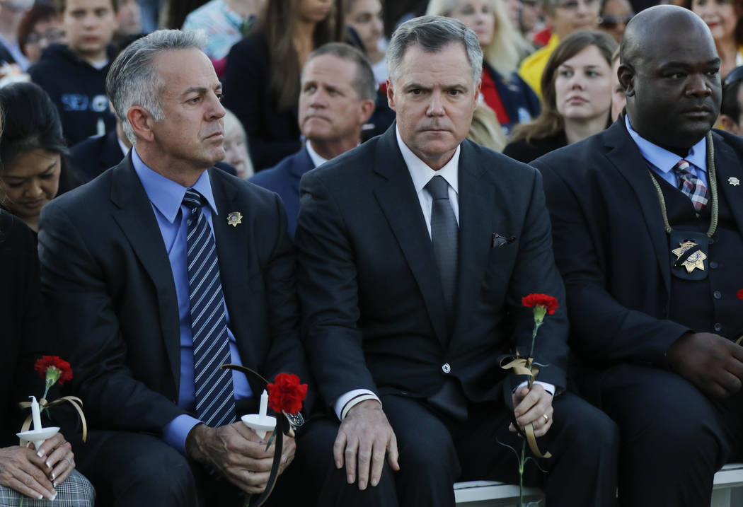 Clark County Sheriff Joe Lombardo, left, and MGM Resorts International Chairman and CEO Jim Murren at the start of a candlelight vigil for Las Vegas police officer Charleston Hartfield, who was ki ...