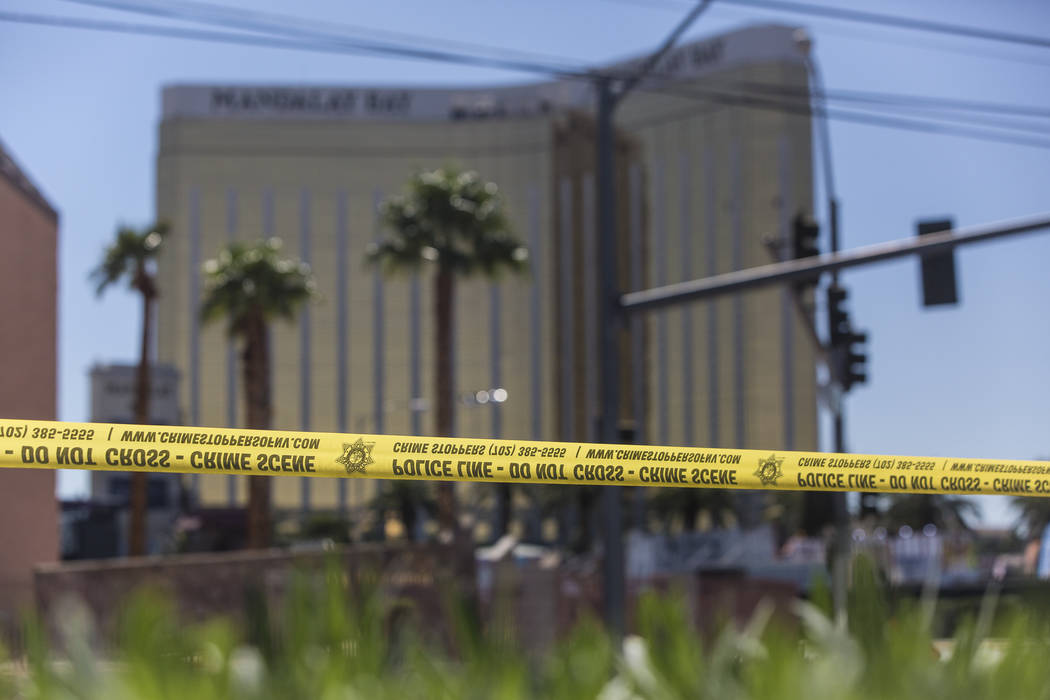 Police tape blocks a section of West Reno Avenue and Las Vegas Boulevard on Monday, October 2, 2017, outside Mandalay Bay in Las Vegas. (Benjamin Hager/Las Vegas Review-Journal) @benjaminhphoto