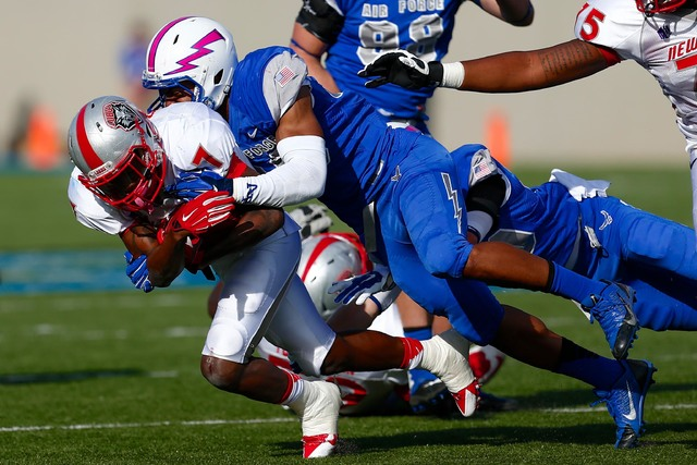 Air Force linebacker Spencer Proctor (36) tackles New Mexico running back Teriyon Gipson (7) on Oct. 18, 2014. (Isaiah J. Downing/USA TODAY Sports)