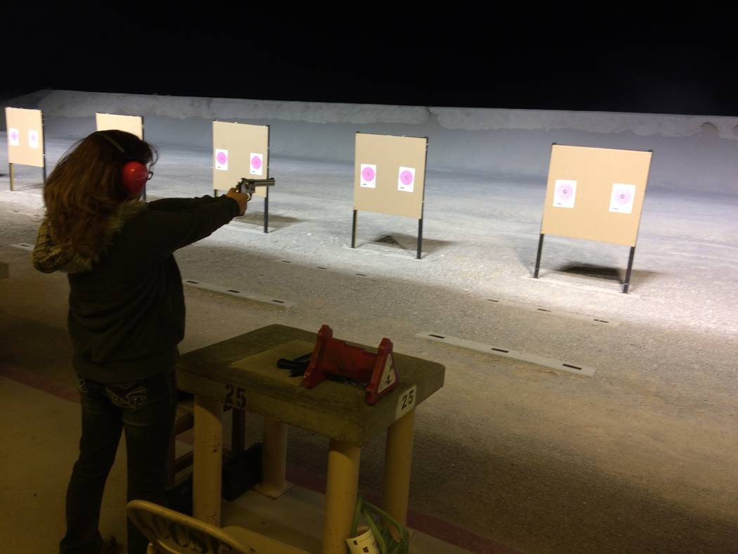 Annette Roskowski aims at a target Oct. 10, 2017, during a session of the Annie Oakley Oakley Women's Shooting Program. The women at the event said the mass shooting had not prompted them to tak ...