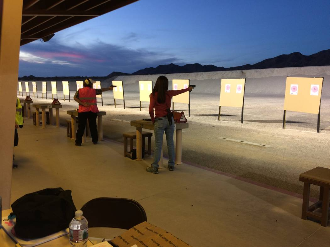 Instructors get in some target practice before women begin showing up for the Annie Oakley Oakley Women's Shooting Program, taught by women for women. The class includes both class and shooting  ...