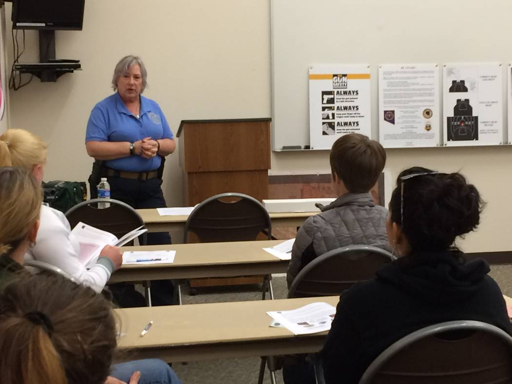 Wendy Jaroslawski, instructor, addresses women on gun safety Oct. 10, 2017, during the indoor training portion of the Annie Oakley Women's Shooting Program. The program began in late April and h ...
