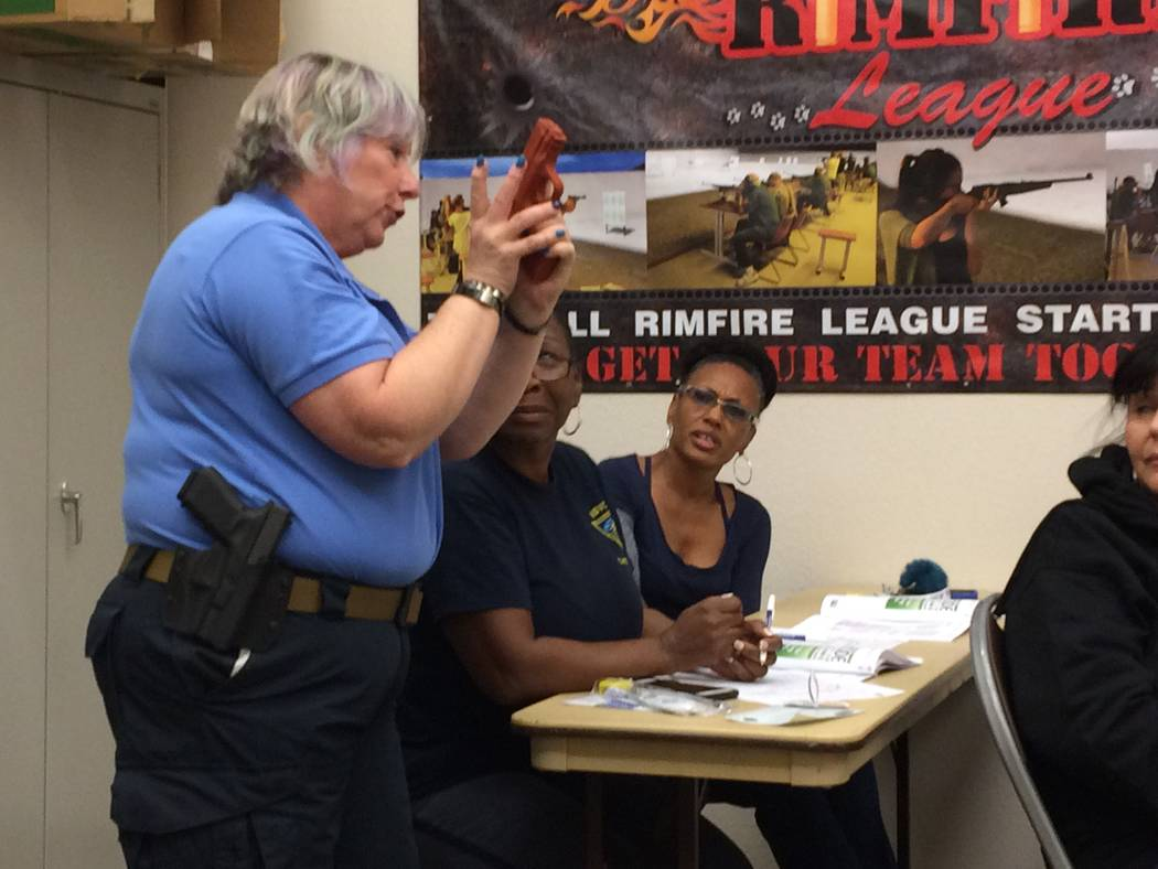 Wendy Jaroslawski, instructor, shows Angel Perry (seated, left) and Angela Dupuy (seated, right) how to hold a gun if one is left handed Oct. 10, 2017, during the indoor training portion of the An ...