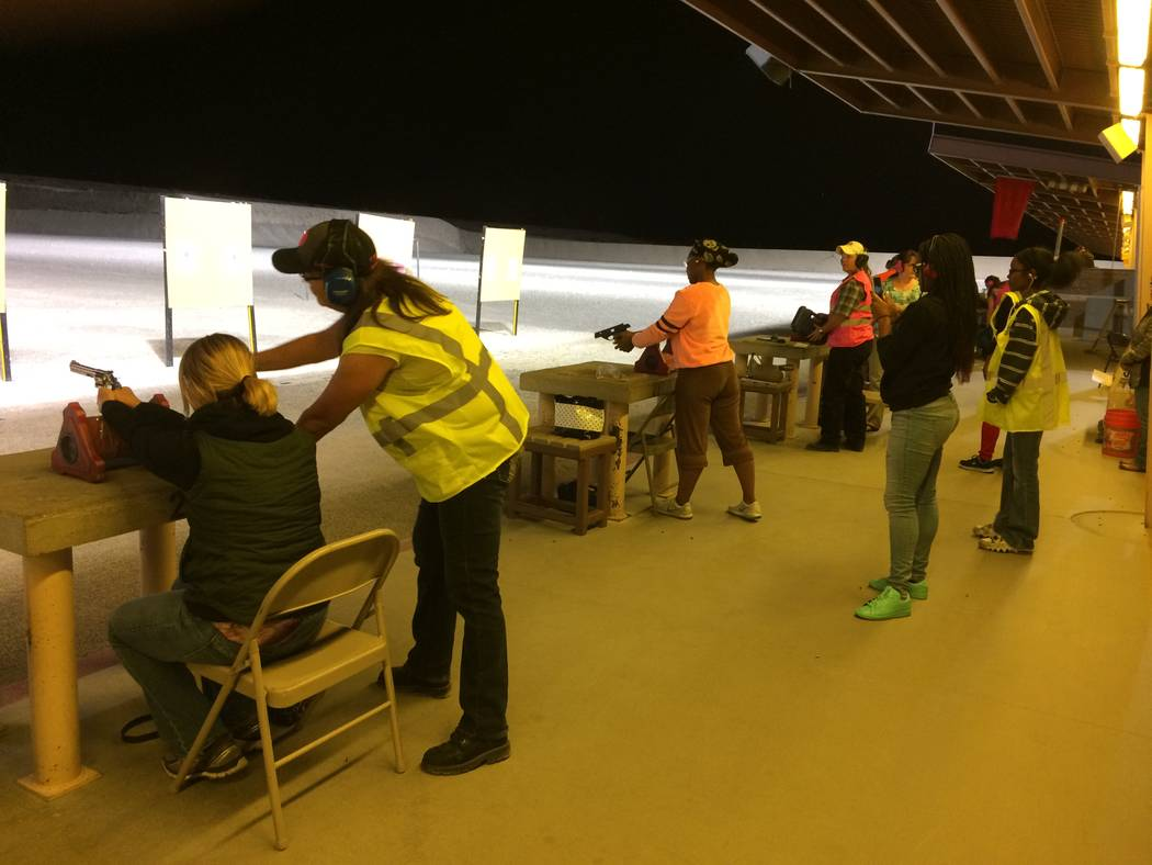 Women take aim during the hands-on portion of Annie Oakley Women's Shooting Program Oct. 10, 2017 at the Clark County Shooting Complex. The program began in late April and the first night, more  ...