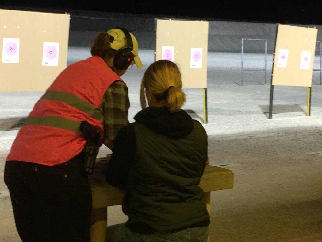 Laura Ward, seated, gets shooting tips Oct. 10, 2017, from Kimberly Davis during an Annie  Oakley Women's Shooting Program. Jeannette Morgan, womens' program director at the shooting complex,  ...