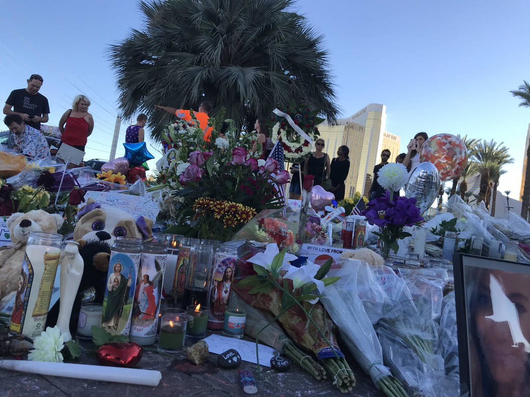 Visitors pay respect to a memorial for the 58 people who were killed in the Oct. 1 massacre in Las Vegas. Blake Apgar Las Vegas Review-Journal @blakeapgar