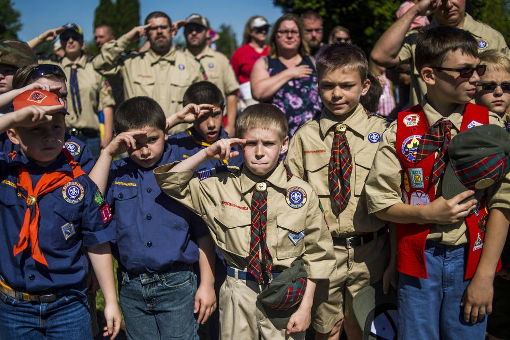Boy Scouts and Cub Scouts salute Monday, May 29, 2017, during a Memorial Day ceremony in Linden, Michigan. On Wednesday, Oct. 11, 2017, the Boy Scouts of America Board of Directors unanimously app ...