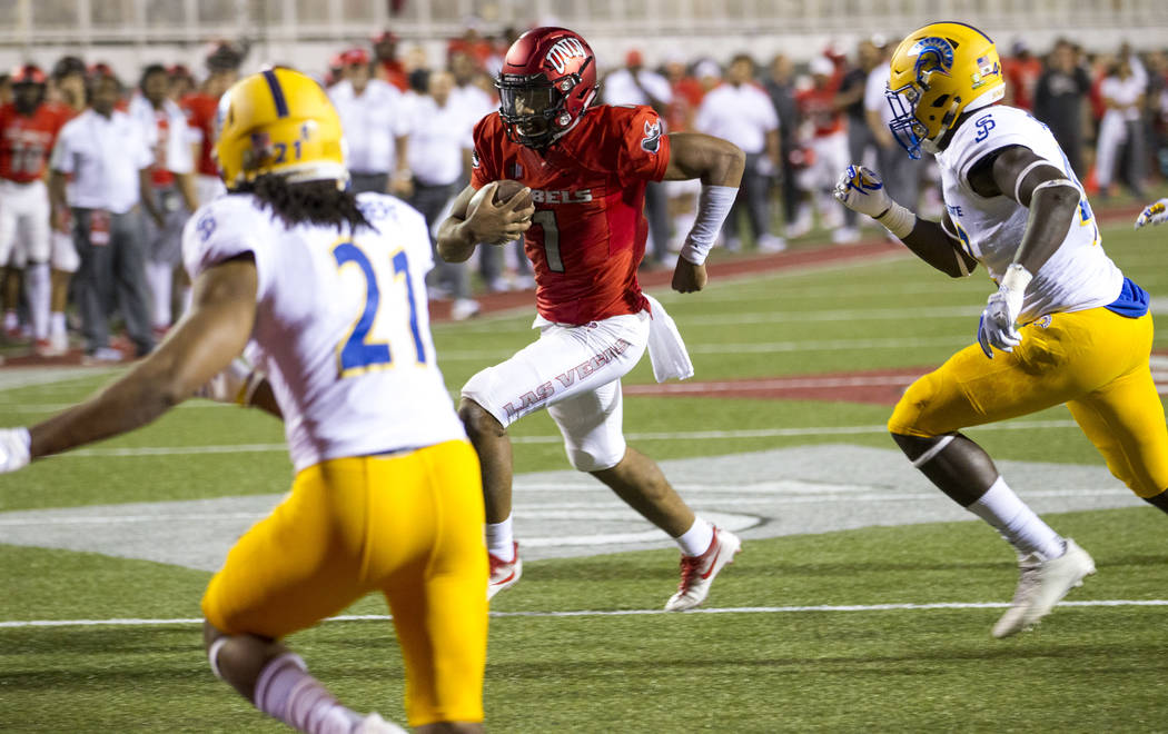 UNLV Rebels quarterback Armani Rogers (1) carries the ball towards the end zone for a touchdown during the first half of an NCAA college football game between the UNLV Rebels and the San Jose Stat ...