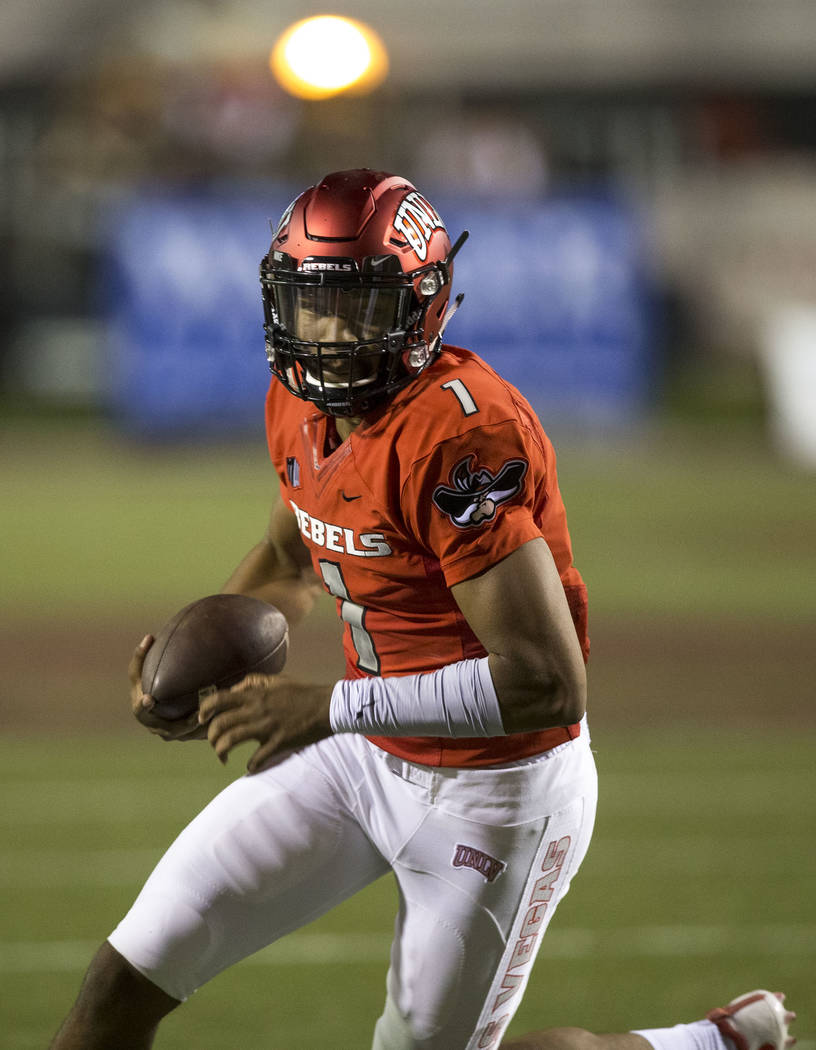UNLV Rebels quarterback Armani Rogers (1) looks for an opening as he runs the ball during the first half of an NCAA college football game between the UNLV Rebels and the San Jose State Spartans at ...
