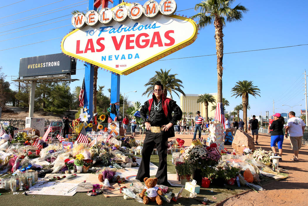 "Jesse Garon, an Elvis impersonator and wedding officiator, Thursday, Oct. 12, 2017 at the ""Welcome to Fabulous Las Vegas"" sign, where a makeshift memorial has been erected for the victims of the L ..."
