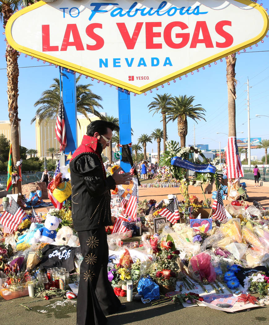 "Jesse Garon, an Elvis impersonator and wedding officiator, Thursday, Oct. 12, 2017 at the ""Welcome to Fabulous Las Vegas"" sign, where a makeshift memorial has been erected for th ..."