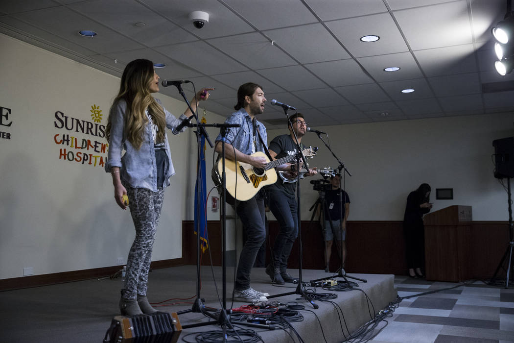The Railers music group from left, Cassandra Lawson, her husband Jonathan and brother-in-law Jordan perform for patients and staff at the Sunrise Hospital auditorium in Las Vegas, Wednesday, Oct.  ...
