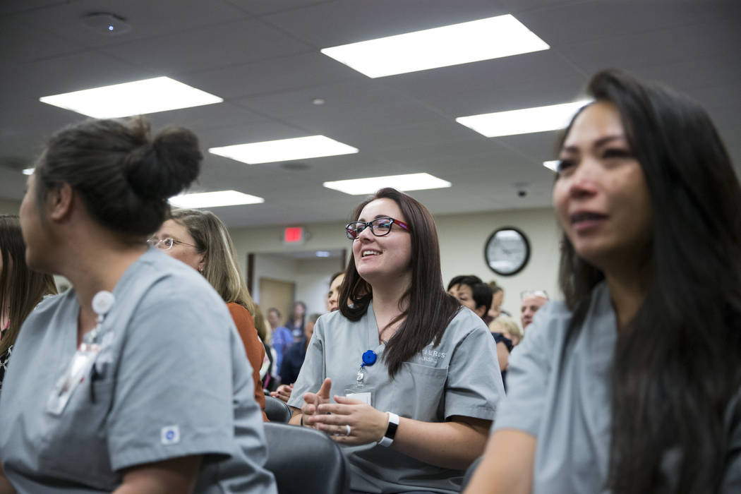 Student nurse Lawren Hinsdale, center, watches a music performance during a concert for patients and staff at the Sunrise Hospital in Las Vegas, Wednesday, Oct. 11, 2017. Several country music art ...