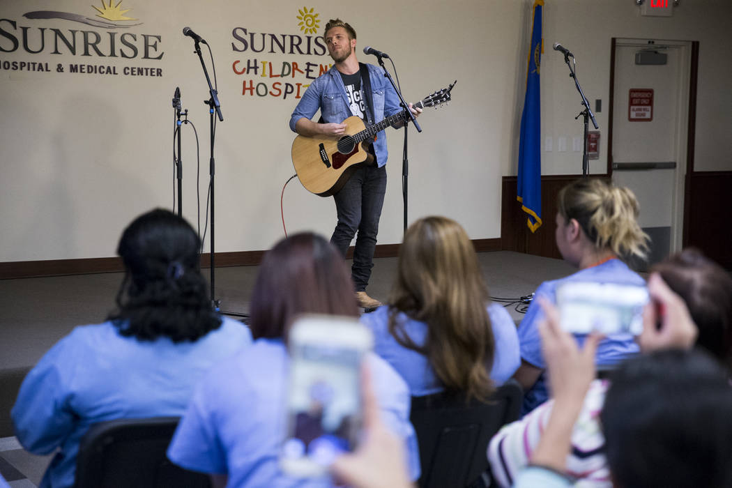Music artist Brandon Ray performs at Sunrise Hospital during a music concert for patients and staff at the hospital auditorium in Las Vegas, Wednesday, Oct. 11, 2017. Ray performed during the Rout ...