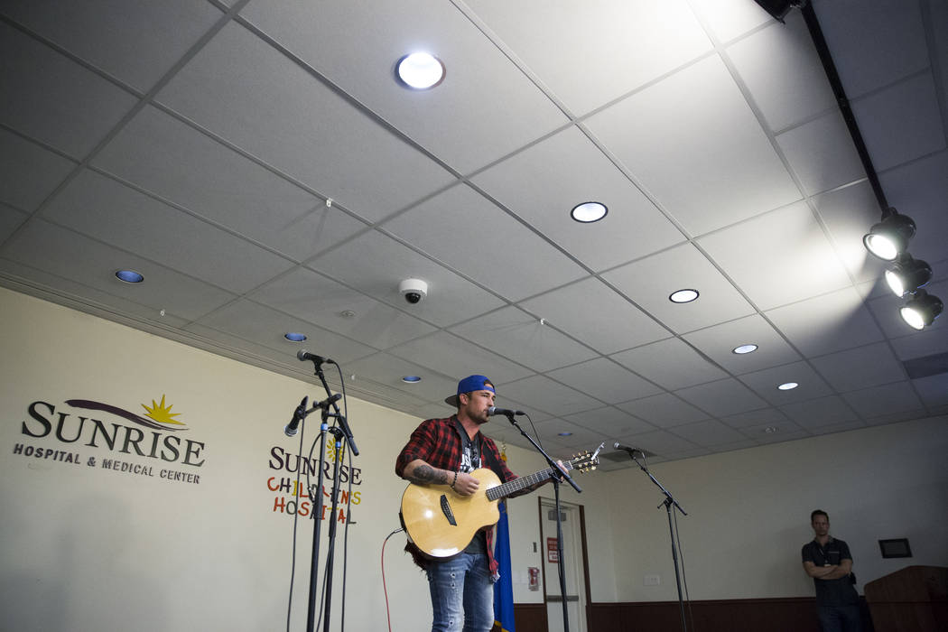 Music artist Michael Ray performs at Sunrise Hospital during a music concert for patients and staff at the hospital auditorium in Las Vegas, Wednesday, Oct. 11, 2017. Ray performed during the Rout ...