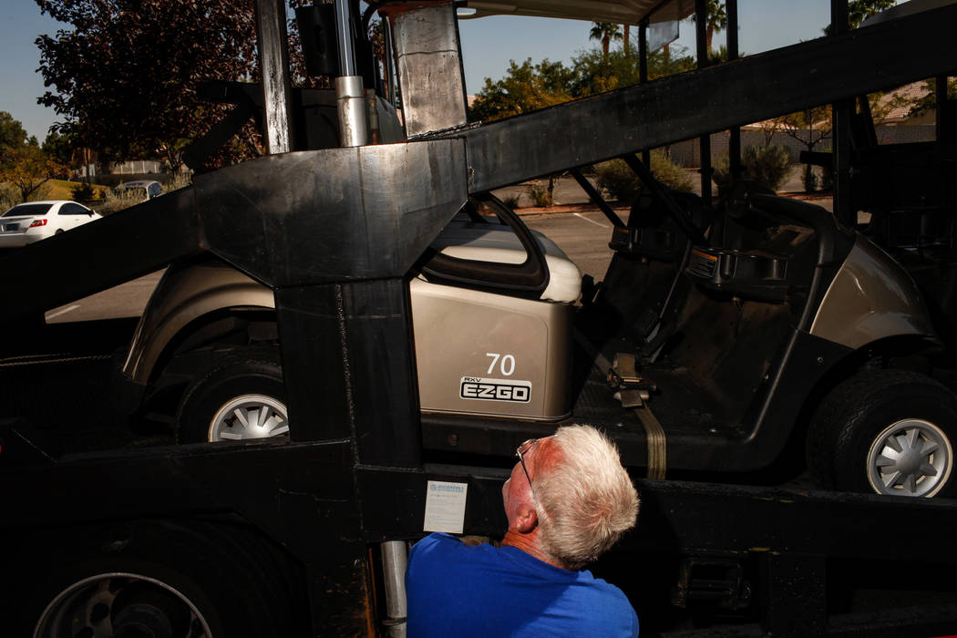 Roland Abby of F&W Transportation, 53, unloads golf cars at Legacy Golf Club in Henderson, Thursday, Oct. 12, 2017. Joel Angel Juarez Las Vegas Review-Journal @jajuarezphoto