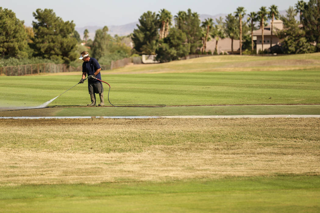 A worker waters the lawn at Legacy Golf Club in Henderson, Thursday, Oct. 12, 2017. Joel Angel Juarez Las Vegas Review-Journal @jajuarezphoto
