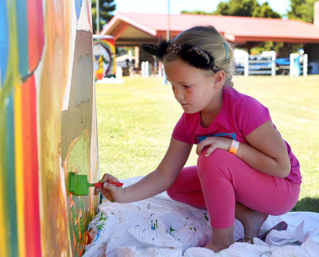 Zoie Smith, 6, helps paint a community mural during the first annual Green Initiative Bluegrass Festival at Craig Ranch Park in North Las Vegas, Sunday, Oct. 15, 2017. Elizabeth Brumley Las Vegas  ...