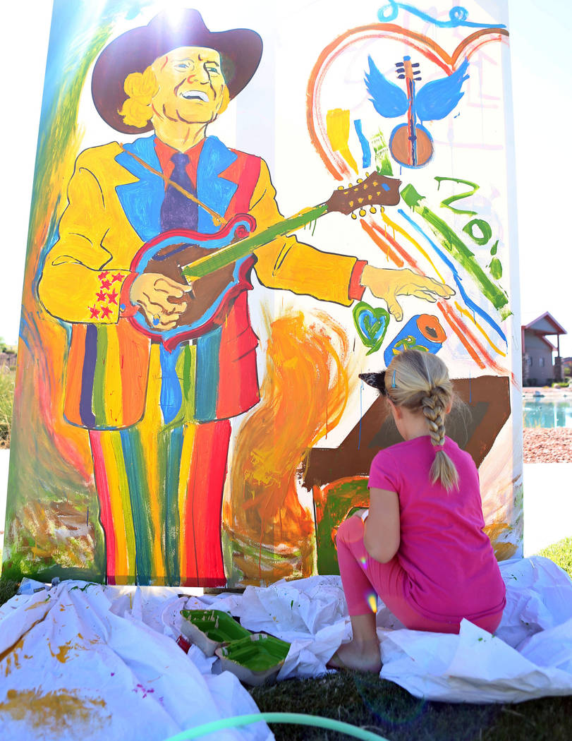 Zoie Smith, 6, helps paint a community mural during the Viva Las VeGrass bluegrass festival at Craig Ranch Park in North Las Vegas, Sunday, Oct. 15, 2017. Elizabeth Brumley Las Vegas Review-Journa ...