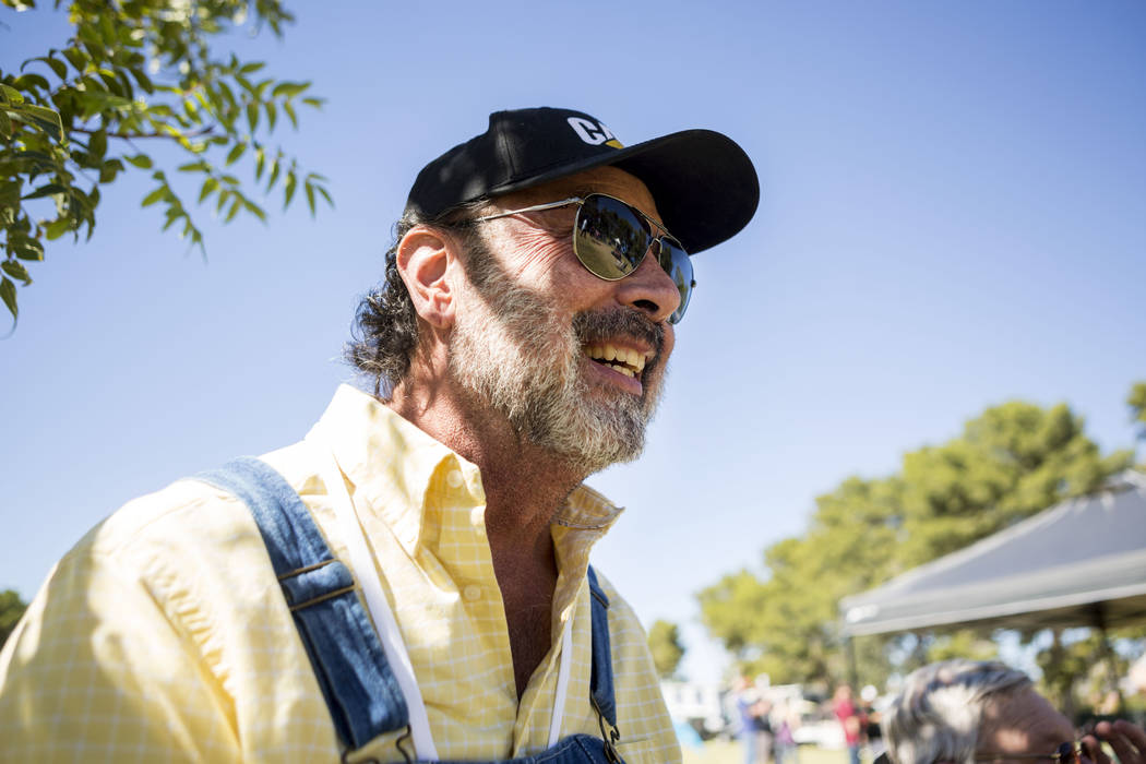 """Kal """"Spunky"""" Catman listens to live music during the first annual Green Initiative Bluegrass Festival at Craig Ranch Park in North Las Vegas, Sunday, Oct. 15, 2017. Elizabeth Bru ..."""