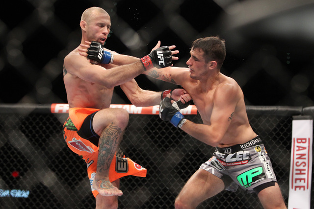 Donald Cerrone and Myles Jury trade blows during their fight at UFC 182 Saturday, Jan. 3, 2015 at the MGM Grand Garden Arena.Cerrone won a unanimous decision. (Sam Morris/Las Vegas Review-Journal)