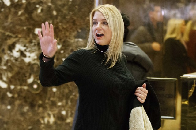 Florida Attorney General Pam Bondi waves to reporters as she arrives at Trump Tower to meet with President-elect Donald Trump, Friday, Dec. 2, 2016, in New York. (Evan Vucci/AP)