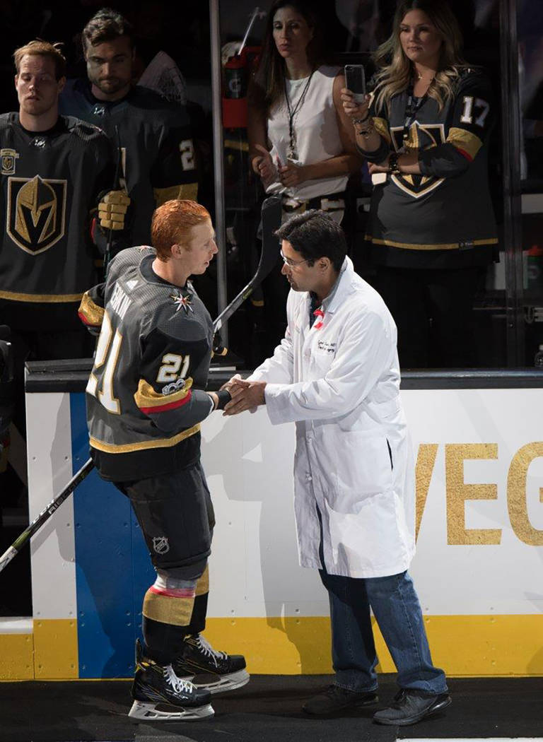 Each Vegas Golden Knights member of the team escorted a doctor, nurse, fireman, police officer onto a carpet at center ice for the national anthem. (Tom Donoghue)