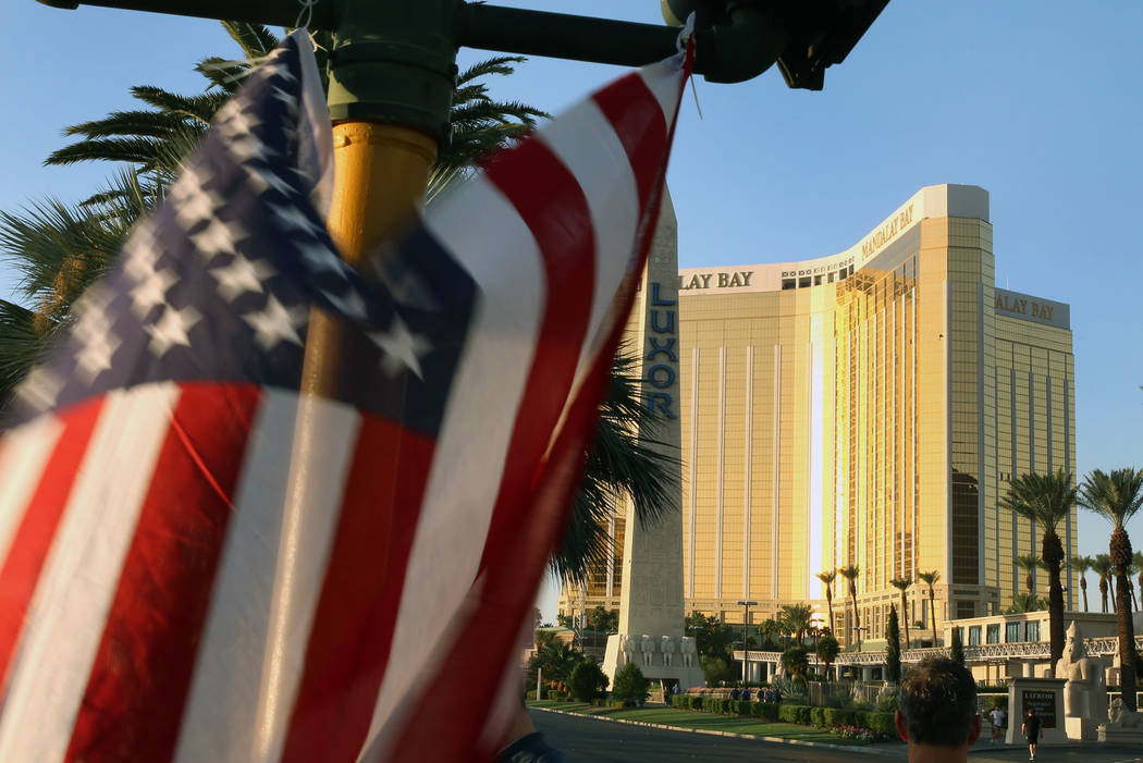 An American flag flies at a makeshift memorial for victims of the Route 91 Harvest mass shooting on Wednesday, Oct. 4, 2017 on Las Vegas Boulevard near Mandalay Bay in Las Vegas. Bizuayehu Tesfaye ...