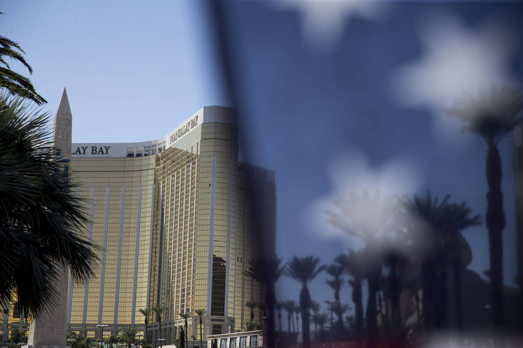 A flag is seen at a makeshift memorial for victims of the Route 91 Harvest mass shooting on Wednesday, Oct. 4, 2017 on Las Vegas Boulevard near Mandalay Bay in Las Vegas. Erik Verduzco/Las Vegas R ...