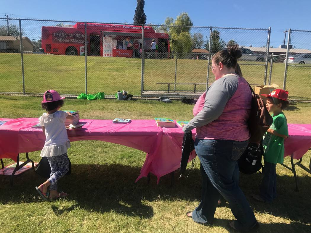 Reading Rainbow attendees getting books on Oct. 7, 2017 at Valley View Park, 2000 Bennett Street. (Kailyn Brown/View) @KailynHype