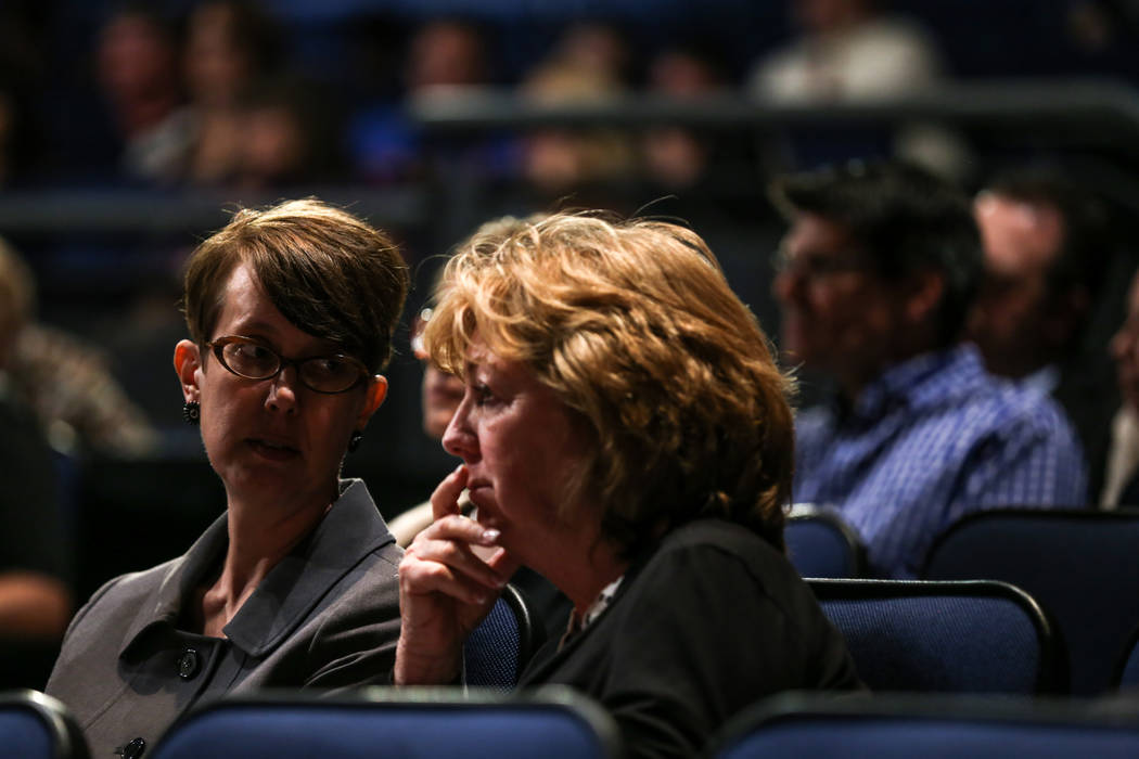 Heidi Swank of the Nevada Preservation Foundation, left, and Marilyn Dondero Loop of the Las Vegas High School Alumni Association, right, listen to a Q&A session during a hearing by the buildi ...