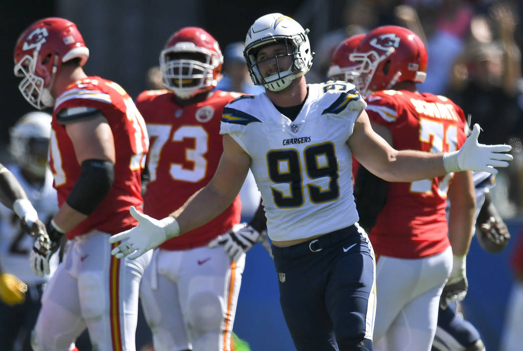 Los Angeles Chargers defensive end Joey Bosa celebrates after sacking Kansas City Chiefs quarterback Alex Smith during the first half of an NFL football game Sunday, Sept. 24, 2017, in Carson, Cal ...