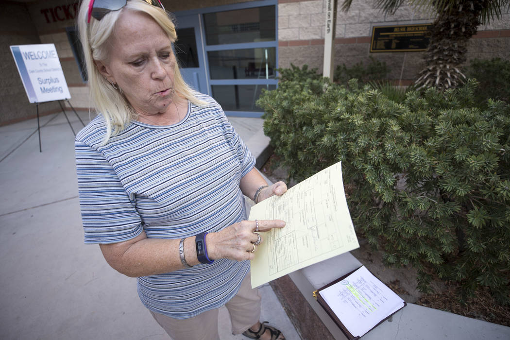 Teacher Sheryl Fields, 65, with her record of licensed personnel transfer slip following a Clark County School District teacher surplus meeting at Del Sol Academy of the Performing Arts in Las Veg ...