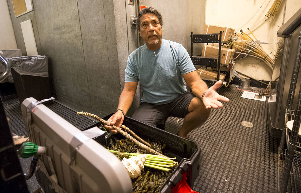 Lei of Aloha organizer Ron Panzo reveals a section of a two-mile, woven ti-leaf lei at the California Hotel on Thursday, Oct. 12, 2017. Richard Brian Las Vegas Review-Journal @vegasphotograph