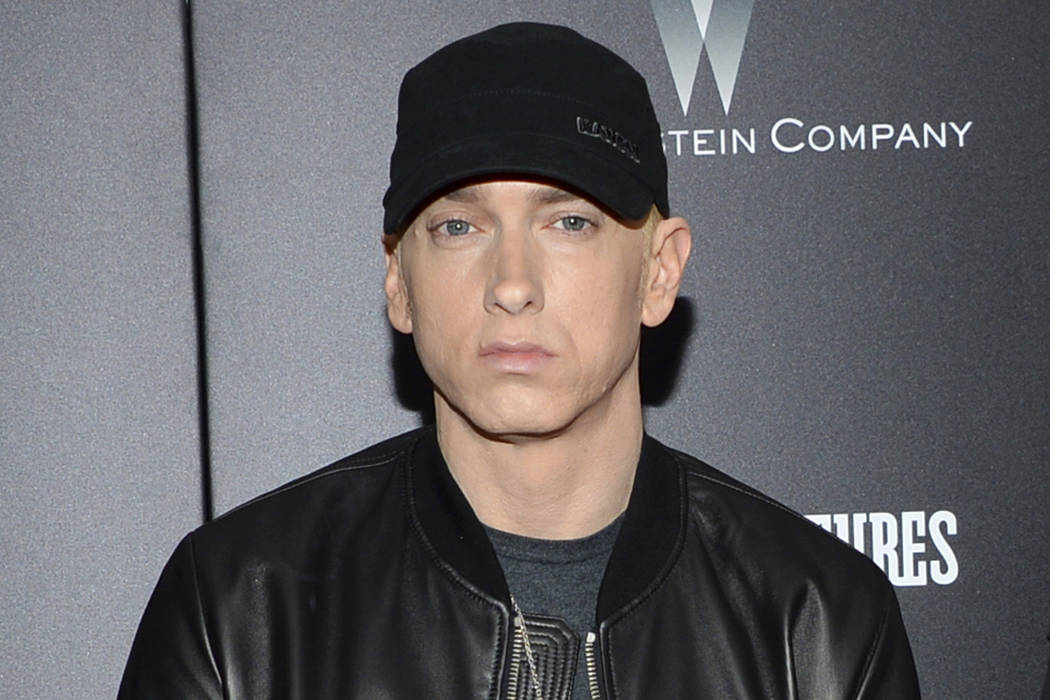 "In this July 20, 2015, file photo, Eminem attends the premiere of ""Southpaw"" in New York. Eminem has released a verbal tirade on President Donald Trump in a video that aired as part of the BET Hip ..."