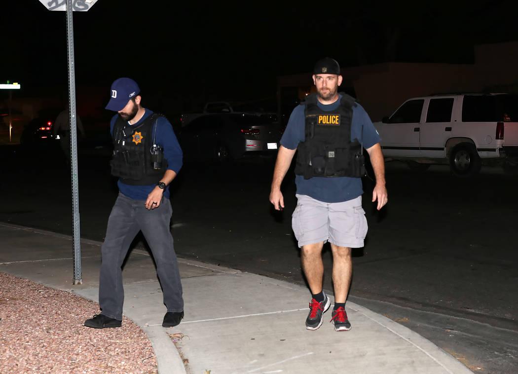 Las Vegas police investigate an officer-involved shooting on 100 block of Moonlight Drive, near Lamb and Charleston boulevards.Wednesday, Oct. 11, 2017, in Las Vegas. Bizuayehu Tesfaye Las Vegas R ...