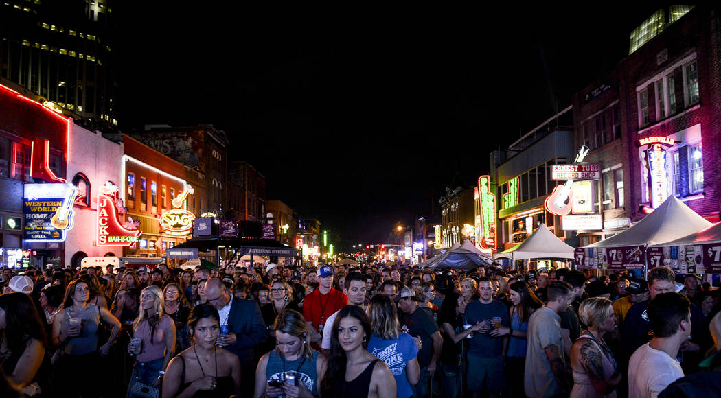 Fans fill a blocked-off section of Nashville's Lower Broadway during the 57th anniversary party for Tootsie's Orchid Lounge. (Ben Neely)