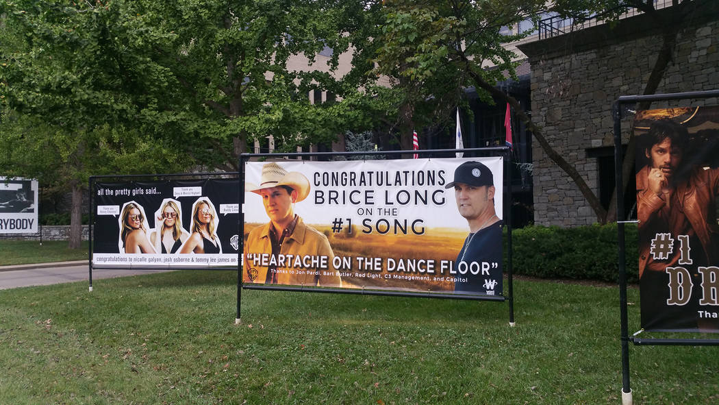 Signs on Warner Nashville's front lawn congratulating artists like Brice Long and Rhett Atkins for their current hits. (Jason Bracelin/Las Vegas Review-Journal)