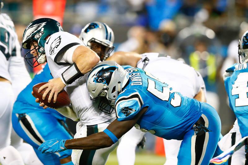 Oct 12, 2017; Charlotte, NC, USA; Carolina Panthers outside linebacker Thomas Davis (58) sacks Philadelphia Eagles quarterback Carson Wentz (11) in the second quarter at Bank of America Stadium. M ...