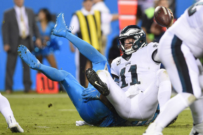 Oct 12, 2017; Charlotte, NC, USA; Philadelphia Eagles quarterback Carson Wentz (11) is sacked by Carolina Panthers outside linebacker Thomas Davis (58) in the second quarter at Bank of America Sta ...