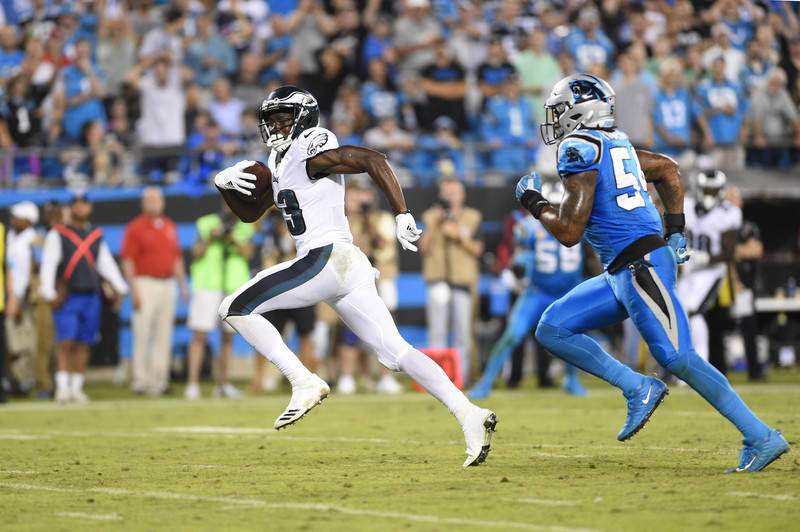 Oct 12, 2017; Charlotte, NC, USA; Philadelphia Eagles wide receiver Nelson Agholor (13) runs for a touchdown as Carolina Panthers outside linebacker Shaq Green-Thompson (54) defends in the fourth  ...
