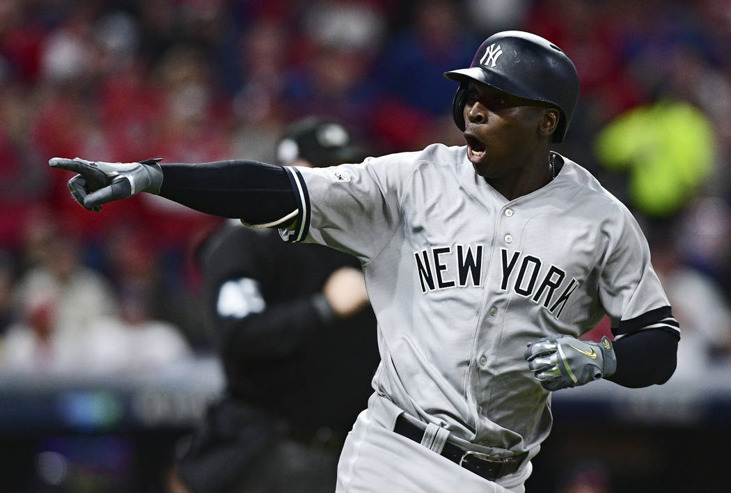 New York Yankees' Didi Gregorius points to the dugout after hitting a two-run home run off Cleveland Indians starting pitcher Corey Kluber during the third inning of Game 5 of a baseball American  ...