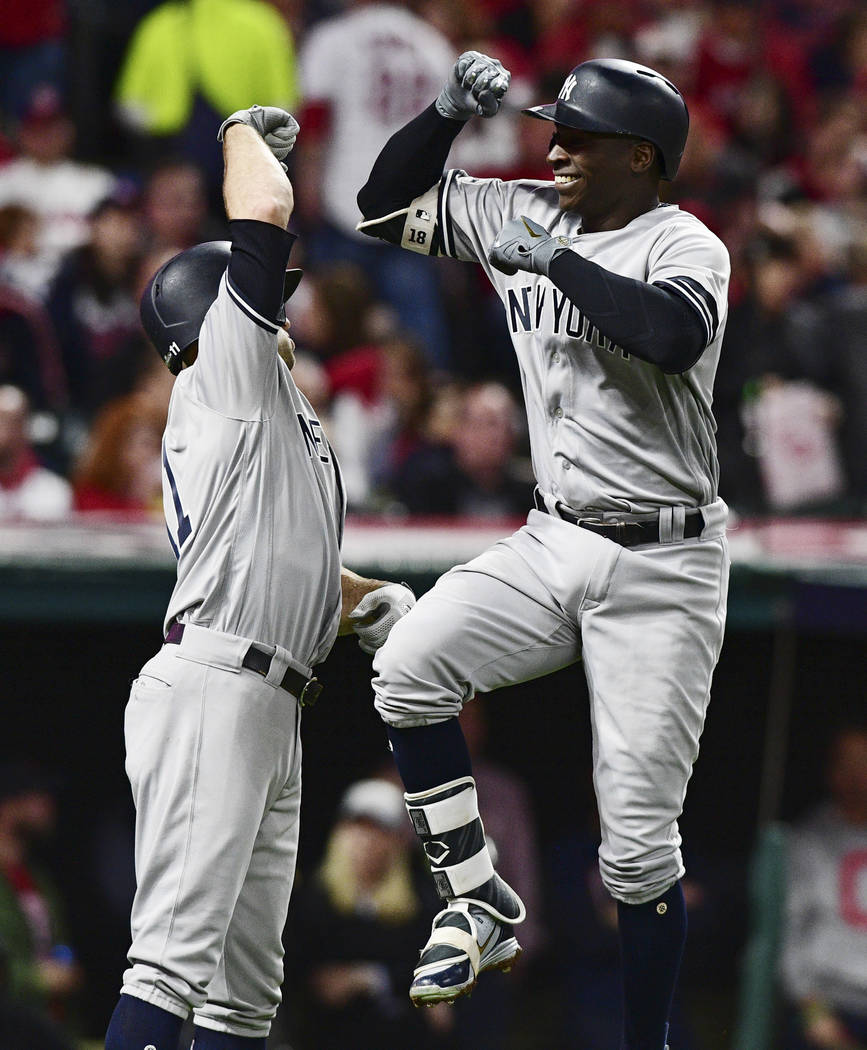 New York Yankees' Didi Gregorius, right, is congratulated by Brett Gardner after Gregorius hit a two-run home run off Cleveland Indians starting pitcher Corey Kluber during the third inning of Gam ...