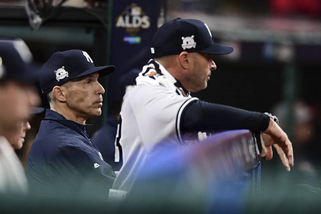 New York Yankees manager Joe Girardi watches from the dugout during the fifth inning of Game 5 of the baseball team's American League Division Series against the Cleveland Indians, Wednesday, Oct. ...