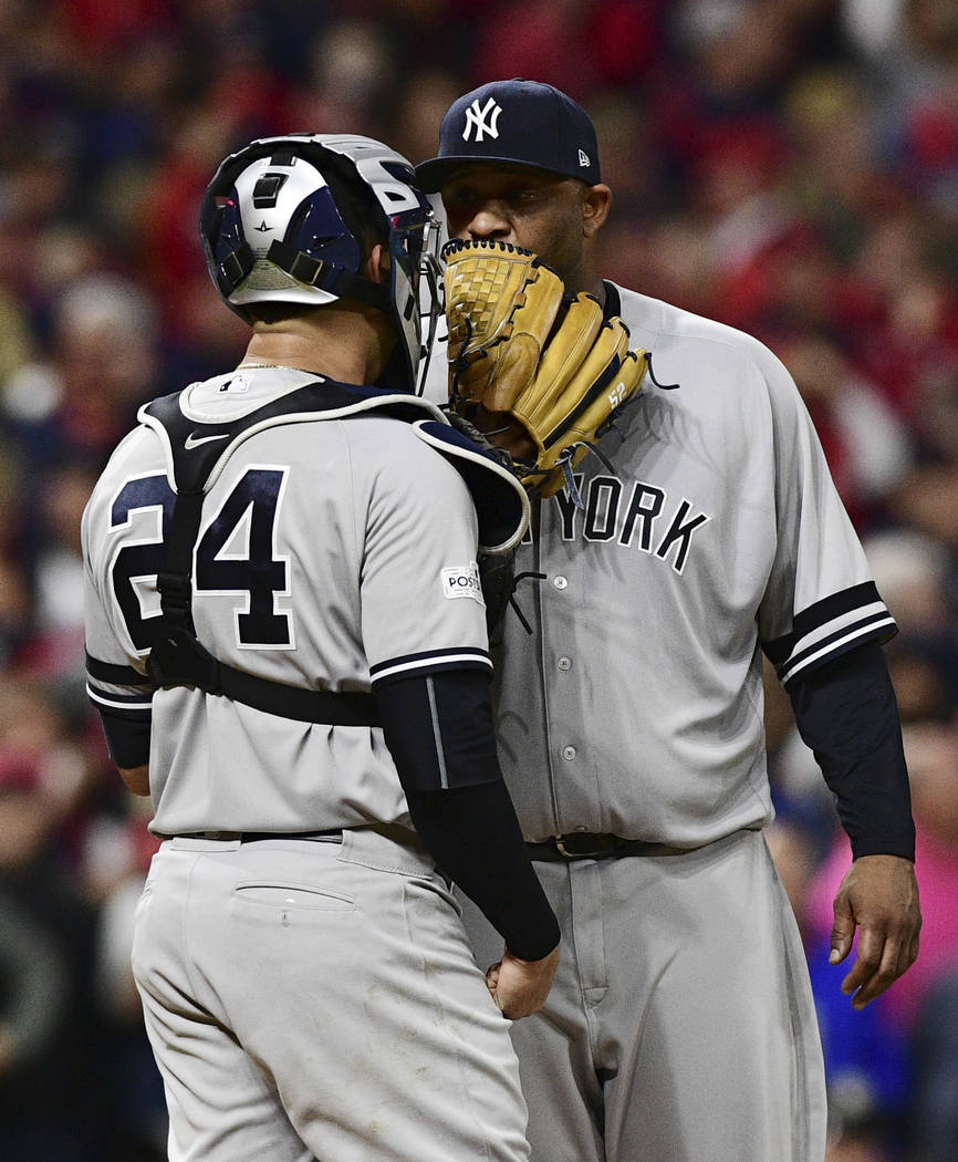 New York Yankees starting pitcher CC Sabathia, right, talks with catcher Gary Sanchez during the fifth inning of Game 5 of the team's baseball American League Division Series against the Cleveland ...